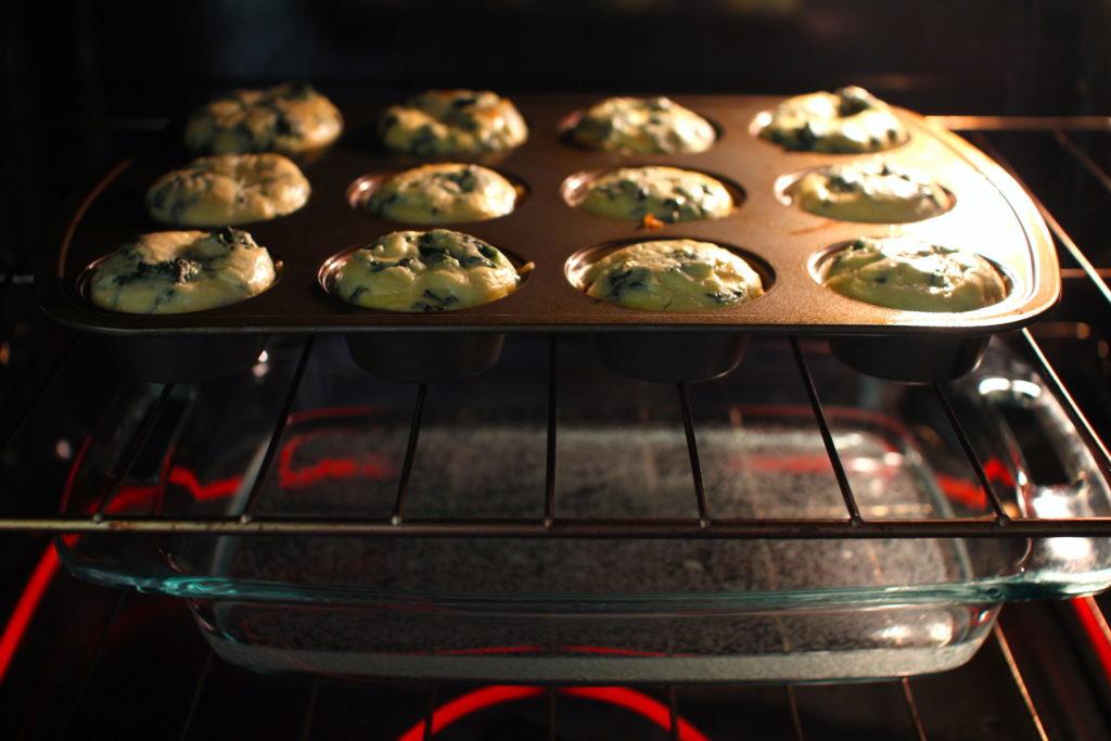 Cheesy Prosciutto Egg Bites in oven